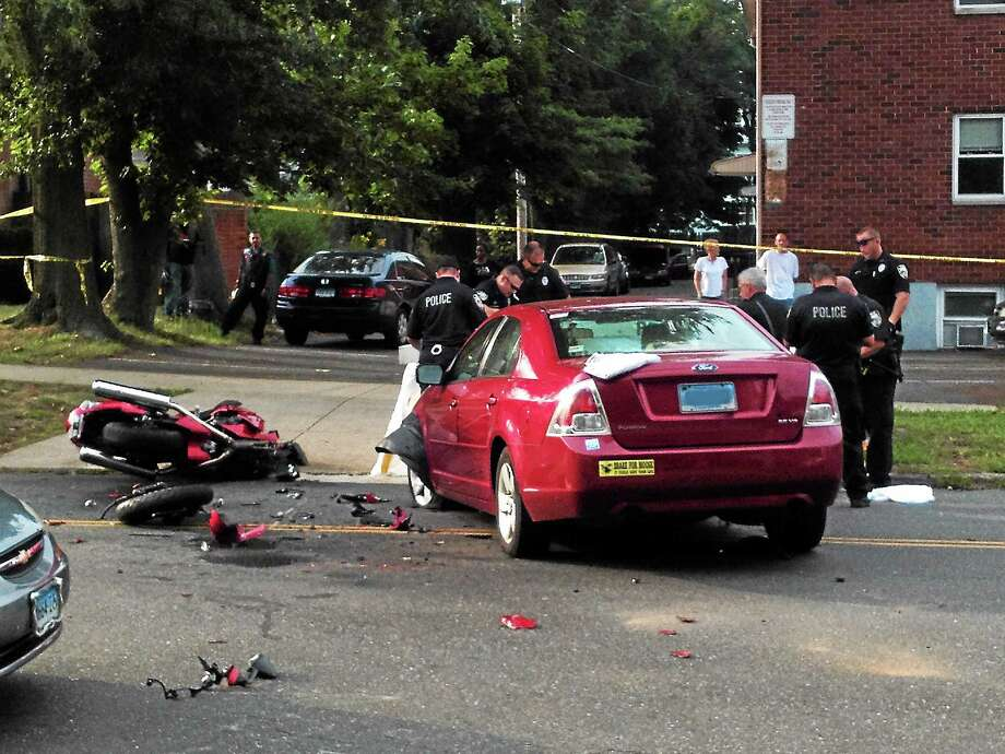 (Mike Bellmore — New Haven Register) Police investigate a fatal motorcycle crash along Main Street in West Haven late Saturday afternoon. Photo: Journal Register Co.