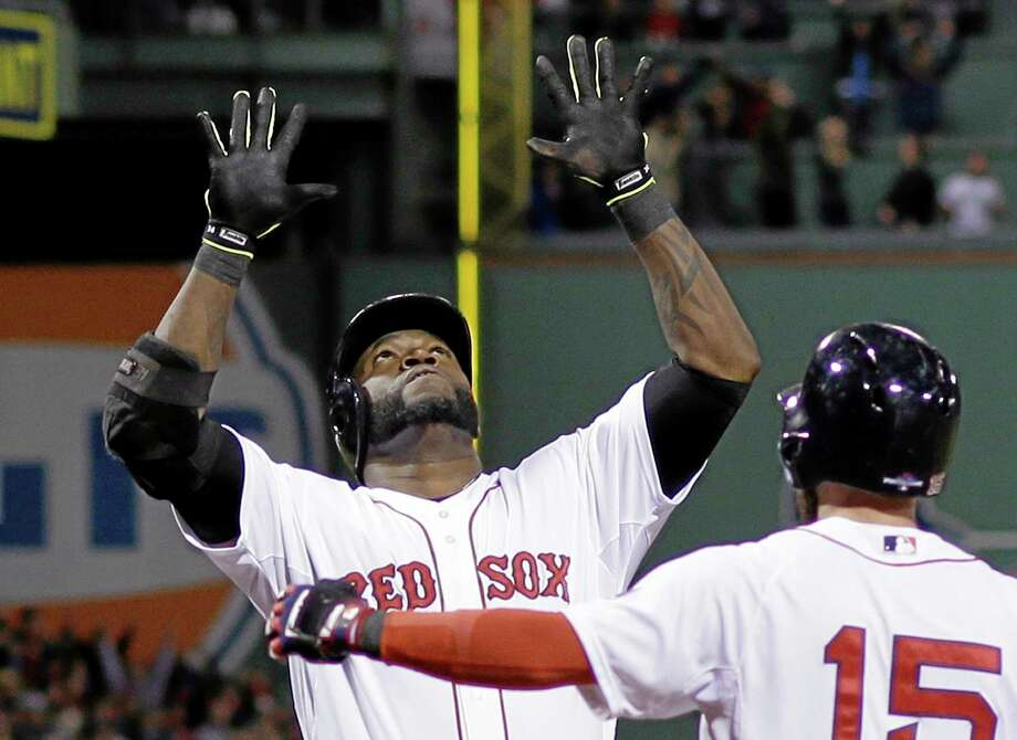 David Ortiz celebrates with Dustin Pedroia after hitting a grand slam in the eighth inning during Game 2 of the ALCS against the Tigers on Sunday in Boston. Photo: Matt Slocum — The Associated Press   / AP