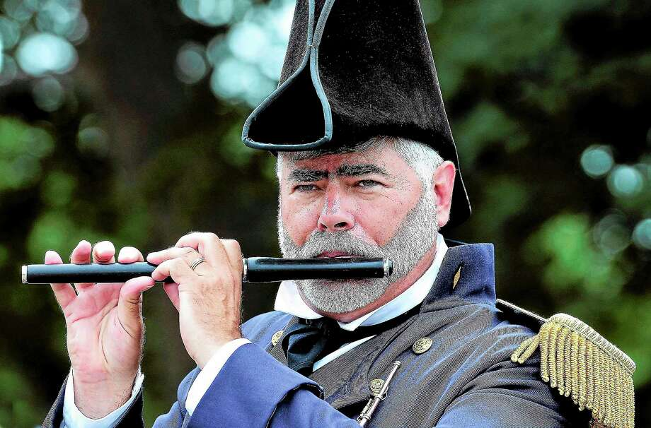 "(Peter Casolino — New Haven Register)   Bob Miorelli of the ""Sailing Masters of 1812"" fire and drum corps plays the fife during a performance at the Clinton town 350th anniversary festival. Photo: Journal Register Co."