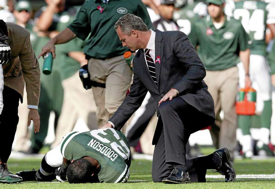 Jets running back Mike Goodson is tended to after being injured on a play during the second half Sunday. Photo: Kathy Willens — The Associated Press   / AP