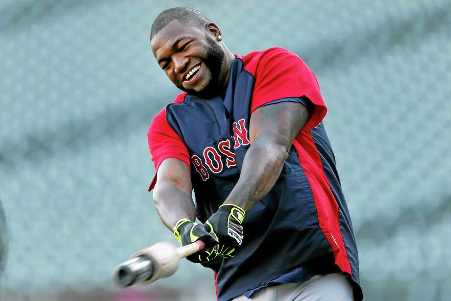 David Ortiz swings a bat during practice at Comerica Park for Game 3 of the ALCS. Photo: Paul Sancya — The Associated Press   / AP