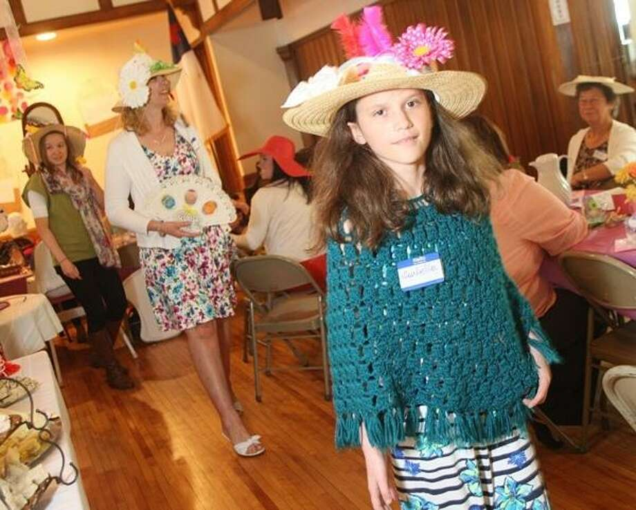 PHOTO BY JOHN HAEGER @ ONEIDAPHOTO ON TWITTER/ONEIDA DAILY DISPATCH Isabella Quackenbush , 10, of Sherrill models her hat she designed during the Celebration Tea on Saturday, May 10, 2013 in Oneida.
