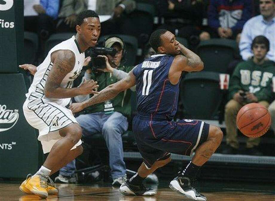 South Florida's Anthony Collins, left, makes the steal against Connecticut's Ryan Boatright during the first half of an NCAA college basketball game Wednesday, March 6, 2013, in Tampa, Fla. (AP Photo/The Tampa Bay Times, Octavio Jones) Photo: AP / The Tampa Bay Times