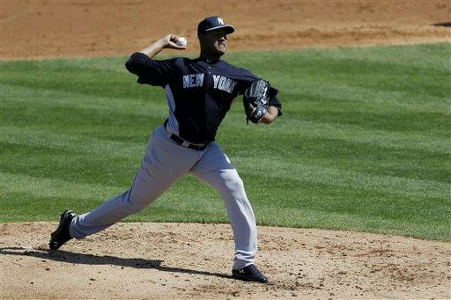 New York Yankees starting pitcher Ivan Nova throws a pitch against the St. Louis Cardinals during the third inning of an exhibition spring training baseball game, Thursday, March 7, 2013, in Jupiter, Fla. (AP Photo/Julio Cortez) Photo: AP / AP
