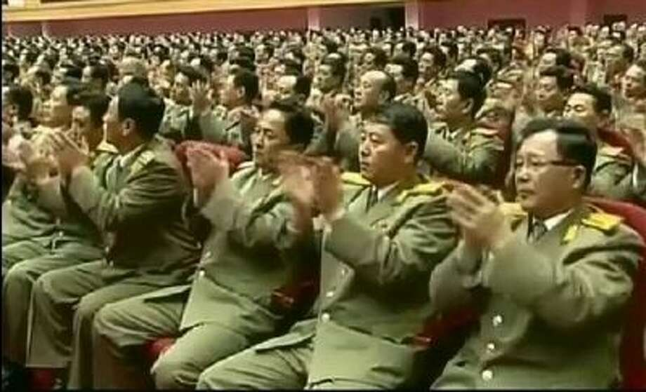 North Korean military officials attend an event Tuesday to mark the second anniversary of the death of former leader Kim Jong Il, in Pyongyang, North Korea. Photo: AP / KRT via AP Video