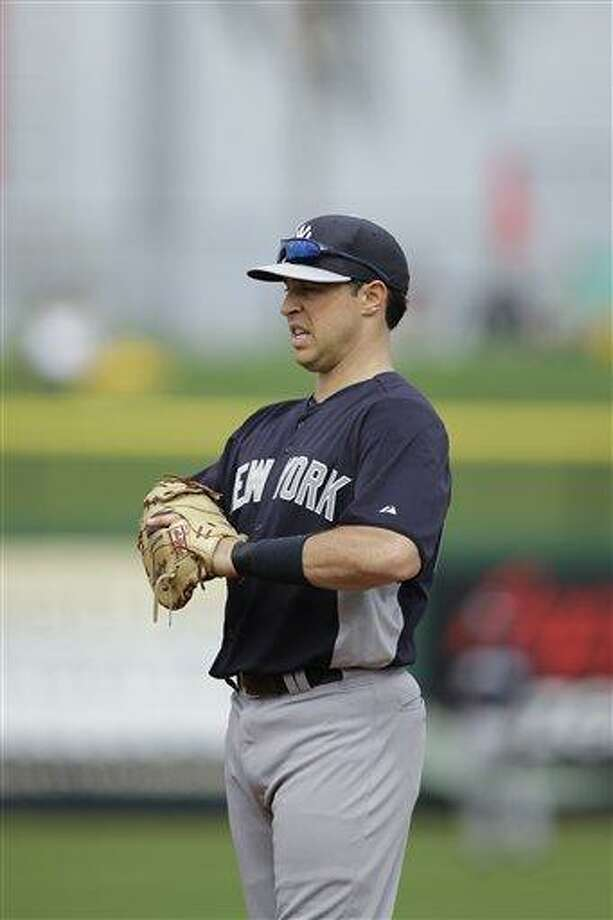 New York Yankees' Mark Teixeira in action during a spring training exhibition baseball game against the Philadelphia Phillies, Tuesday, Feb. 26, 2013, in Clearwater, Fla.(AP Photo/Matt Slocum) Photo: AP / AP