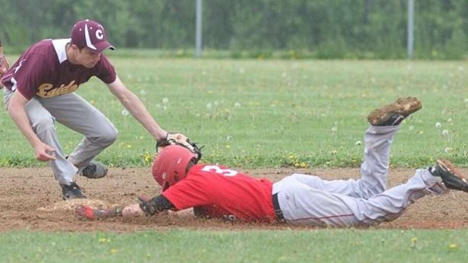 PHOTO BY JOHN HAEGER @ ONEIDAPHOTO ON TWITTER/ONEIDA DAILY DISPATCH VVS' Christian Tiffin (3) steals second, sliding under the tag by Canastota's John Popple (5) in the second game of the double header on Saturday in Verona.