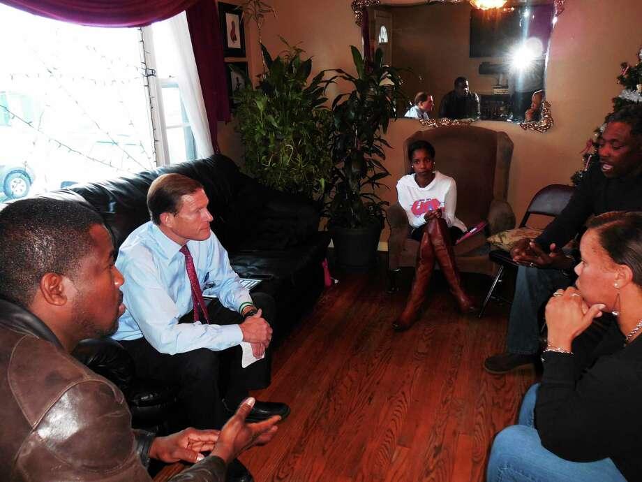 U.S. Sen. Richard Blumenthal meets with Gregory and Celeste Fulcher, parents of slain West Haven resident Erika Robinson. Photo: Shahid Abdul-Karim — New Haven Register