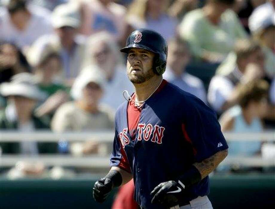 Boston Red Sox's Mike Napoli hits a three-run home run in the fourth inning of a spring training exhibition baseball game against the Minnesota Twins, Thursday, March 7, 2013, in Fort Myers, Fla. (AP Photo/David Goldman) Photo: AP / AP
