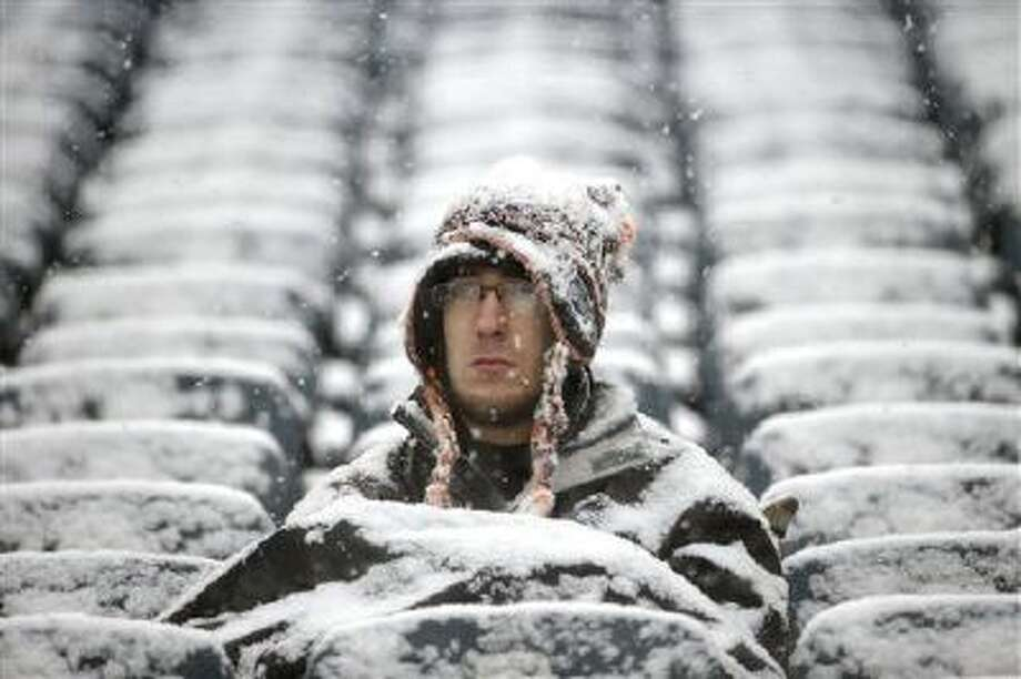 A fan sits in the stands at Lincoln Financial Field before an NFL football game, Sunday, Dec. 8, 2013, in Philadelphia. Photo: AP / AP