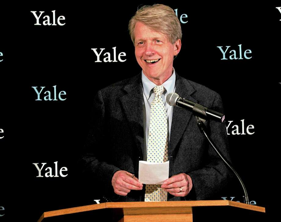 (Melanie Stengel — New Haven Register )  Yale professor Robert Shiller speaks at Yale's Woolsey Hall after being introduced by Yale President Peter Salovey. Shiller was awarded a Nobel Memorial Prize for Economics on Monday. Photo: Journal Register Co.
