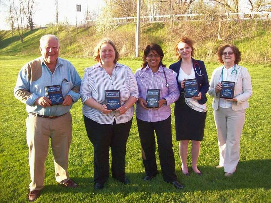 Photo by Mike Jaquays Mary Rose Center volunteer Doctors, from left, Robert Pickels, Jennifer Cesana, Rathika Martyn, Jennifer Quinn, and Marcia Newsom hold the plaques awarded to them by Gorman Foundation president Amanda Larson on May 1, 2013. The Gorman Foundation, who created the Oneida clinic for the uninsured with Dr. Martyn in 2010, made the presentation in honor of the recent National Doctors Day and Volunteers Week.