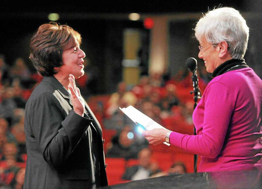 (Peter Hvizdak — New Haven Register)Lt. Governor Nancy Wyman gives the inaugural oath to Derby Mayor Anita Dugatto, the first female and 30th Mayor of Derby, during the City of Derby Inauguration Ceremony Saturday December 7, 2013 at Derby High School. Photo: New Haven Register / ©Peter Hvizdak /  New Haven Register