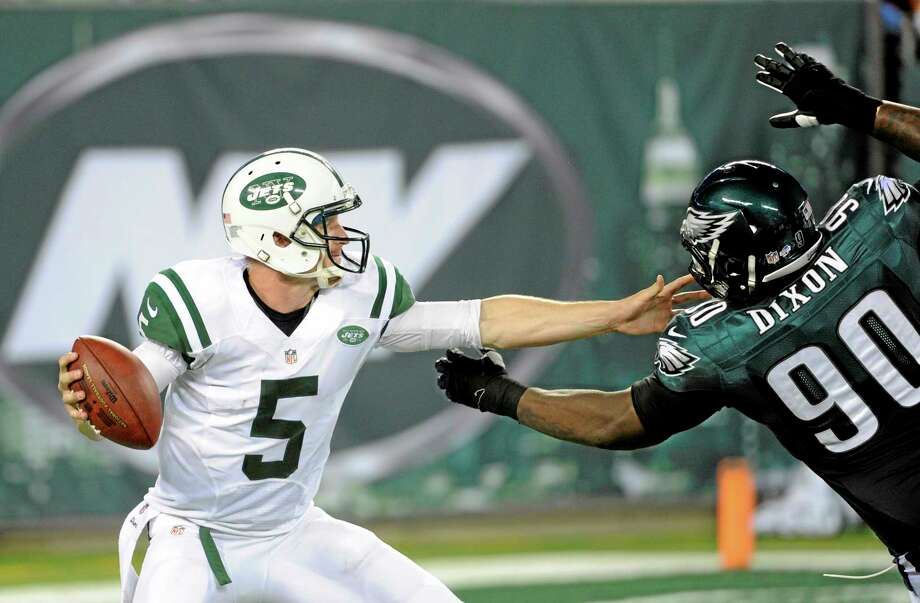 New York Jets quarterback Matt Simms (5) tries to protect himself as Philadelphia Eagles defensive tackle Antonio Dixon (90) rushes in during the first half of a preseason NFL football game, Thursday, Aug. 29, 2013, in East Rutherford, N.J. (AP Photo/Bill Kostroun) Photo: AP / FR51951 AP