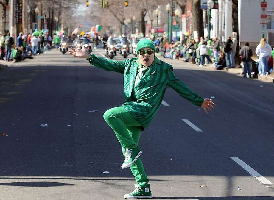 Richard Bengivengo of New Haven cuts up before watching the St. Patrick's Day Parade, New Haven. Photo by Mara Lavitt/New Haven Register3/11/12
