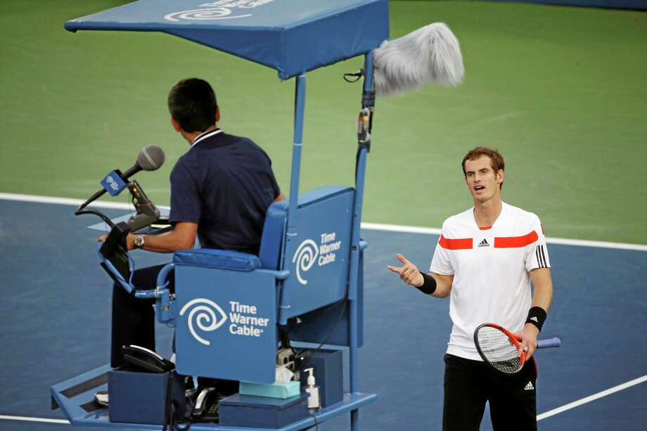 Andy Murray questions the umpire on a shot that was called out during the second round against Leonardo Mayer of Argentina at the 2013 U.S. Open tennis tournament, Friday. Photo: David Goldman — The Associated Press   / AP