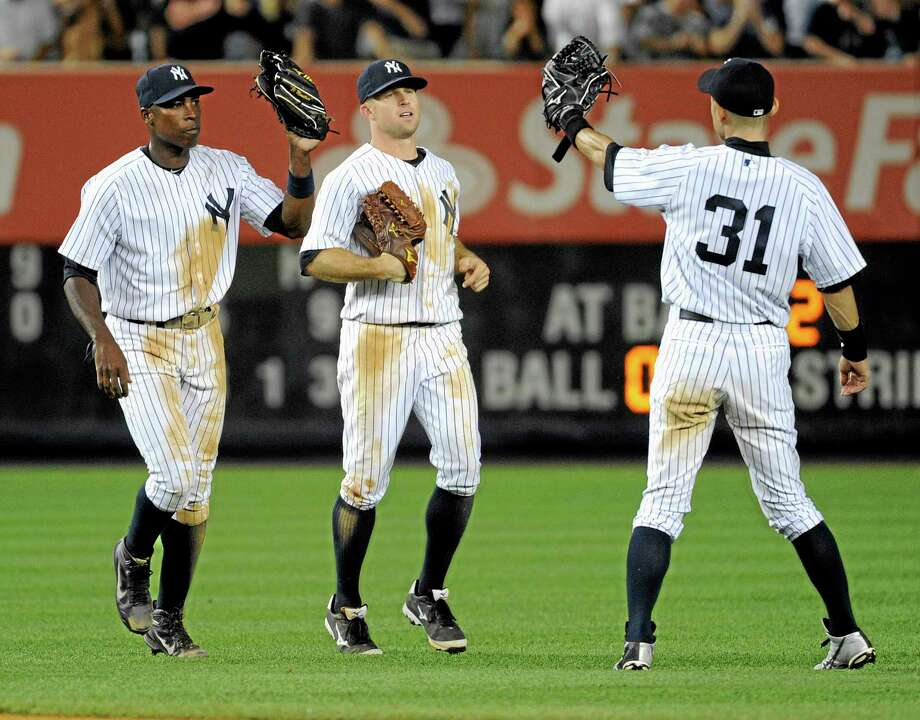 The Yankees' Alfonso Soriano, left, Brett Gardner, and Ichiro Suzuki (31), of Japan, celebrate after defeating the Baltimore Orioles, 8-5. Photo: Bill Kostroun — The Associated Press   / FR51951 AP