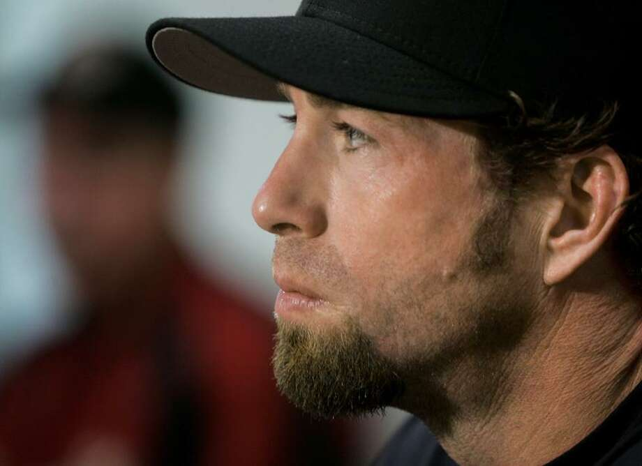 Houston Astros' Jeff Bagwell answers questions during a news conference Saturday, March 25, 2006, in Kissimmee, Fla.  Bagwell said Saturday he will start the season on the disabled list and isn't sure if he'll return this year. The 37-year-old Bagwell, perhaps the most popular player in franchise history, spent the spring in a contentious battle with the team while he tried to prove he could still play despite a chronically injured right shoulder. (AP Photo/Tony Dejak) Photo: ASSOCIATED PRESS / AP2006