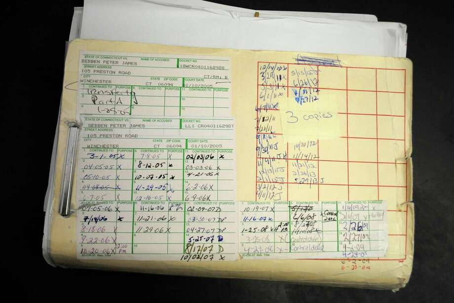 The case file kept at Litchfield Superior Court on Peter Sebben is overflowing with documents and shows how many appearances he has made since his 2004 arrest. Jessica Glenza/Register Citizen.