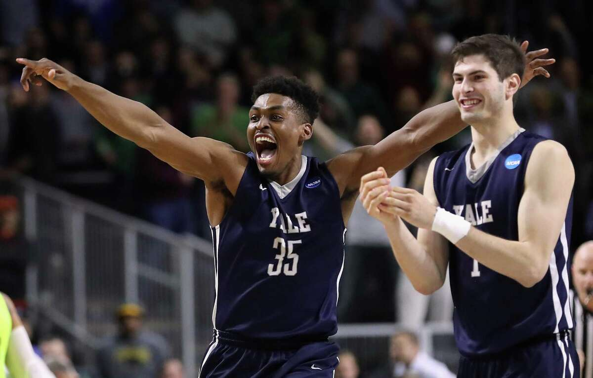 Yale's Brandon Sherrod, left, and Anthony Dallier celebrate defeating the Baylor Bears 79-75 during the first round of the 2016 NCAA men's basketball tournament on March 17, 2016, at Dunkin' Donuts Center in Providence, R.I.