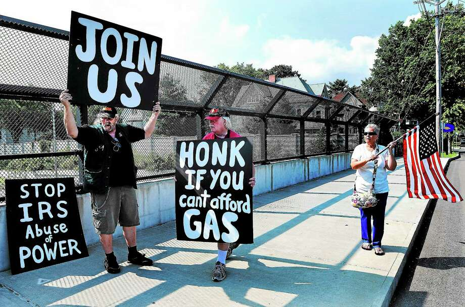 """(Peter Casolino — New Haven Register)   Ronald Peterson, left, Palin Smith, center, and Barbara Atwood protest on the Howard Avenue overpass. The protesters were calling for Obama's impeachment in a series of planned nationwide protests titled; """"Overpasses to Impeach Obama.""""  Peterson is from Seymour, Smith is from Woodbury and Atwood is from Watertown. Photo: Journal Register Co."""