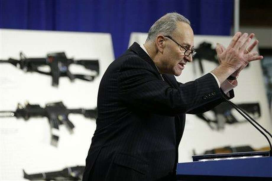 FILE - In this Jan. 24, 2013 file photo, Sen. Charles Schumer, D-N.Y., speaks during a news conference with a coalition of members of Congress, mayors, law enforcement officers, gun safety organizations and other groups on Capitol Hill in Washington to introduce legislation on assault weapons and high-capacity ammunition feeding devices. The Senate Judiciary Committee approved legislation Thursday toughening laws against people who illegally buy guns for others as lawmakers cast their first votes in Congress to curb firearms since December's horrific shootings at a Connecticut elementary school.    (AP Photo/Manuel Balce Ceneta, File) Photo: AP / AP