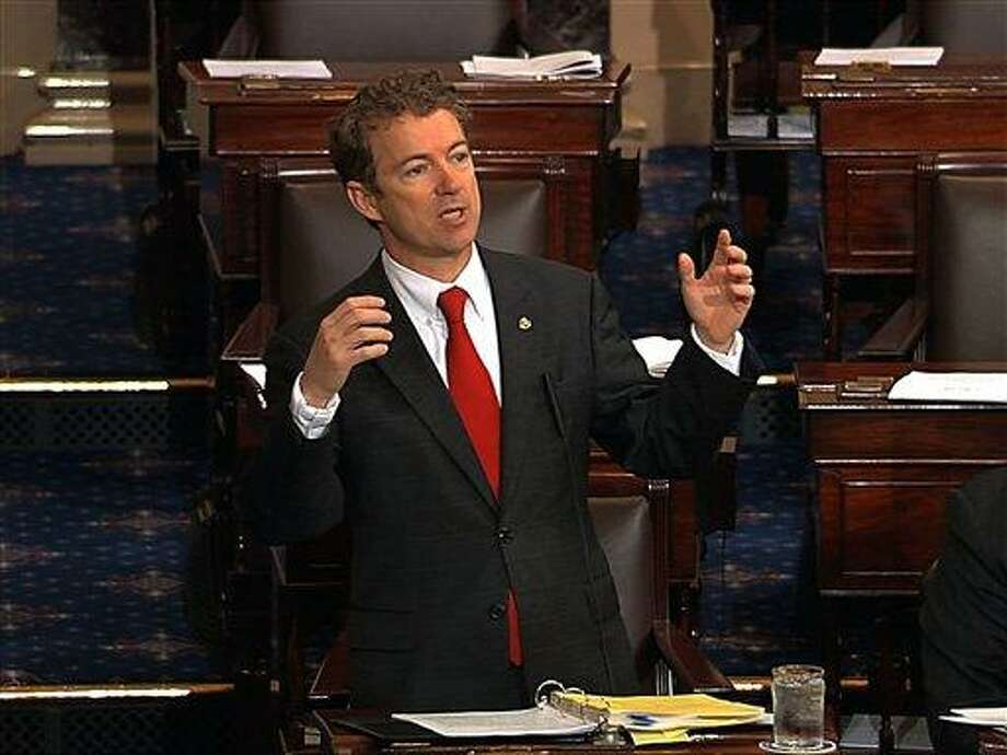 This video frame grab provided by Senate Television shows Sen. Rand Paul, R-Ky. speaking on the floor of the Senate on Capitol Hill in Washington, Wednesday, March 6, 2013. Senate Democrats pushed Wednesday for speedy confirmation of John Brennan's nomination to be CIA director but ran into a snag after a Paul began a lengthy speech over the legality of potential drone strikes on U.S. soil. But Paul stalled the chamber to start what he called a filibuster of Brennan's nomination. Paul's remarks were centered on what he said was the Obama administration's refusal to rule out the possibility of drone strikes inside the United States against American citizens.  (AP Photo/Senate Television) Photo: AP / Senate Television
