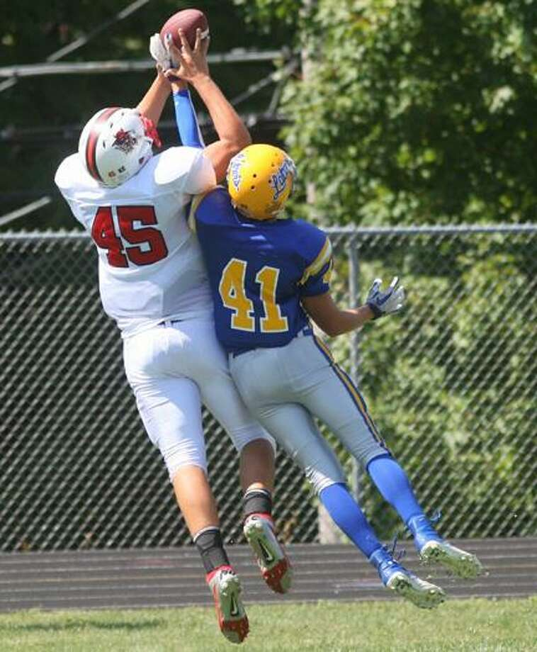 Dispatch Staff Photo by JOHN HAEGER (Twitter: @OnedaPhoto) VVS' Brett Field (45) tries to outjump Cazenovia's Chad Warren (41) for a pass during their season opener. Field was named All-State Third Team as an offensive end.