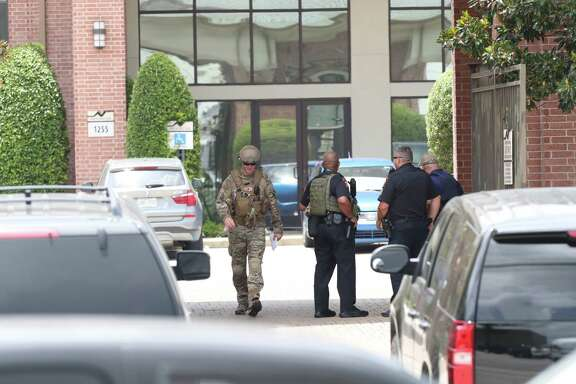 Police and SWAT search for bank robbery suspects in an apartment complex at 1255 N Post Oak. One car with four suspects led police on a chase that ended at that complex. Residents were instructed to remain indoors as a SWAT team swarmed the complex.