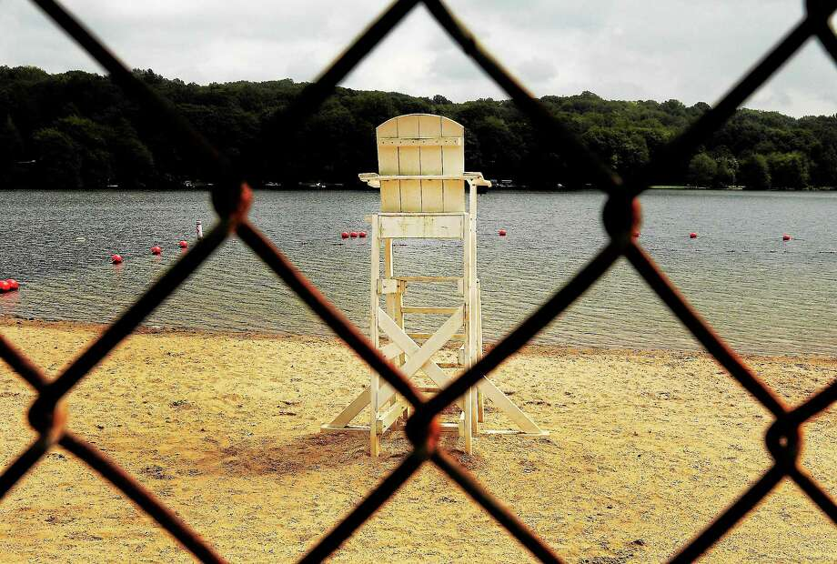 (Peter Hvizdak — Register)Empty lifeguard stand at Lake Quonnipuag in Guilford, Conn. Thursday August 30, 2013. Photo: New Haven Register / ©Peter Hvizdak /  New Haven Register