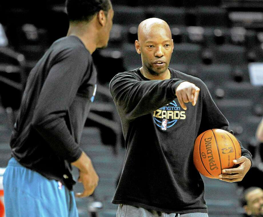 Sam Cassell, currently an assistant coach with the Washington Wizards, will be rooting for UConn in the coming years after his son committed to play for the Huskies. Photo: Chuck Burton — The Associated Press   / AP2011