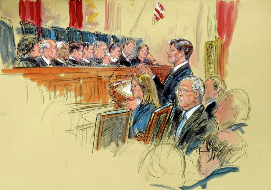 This artist rendering shows Senate Minority Leader Mitch McConnell of Ky., seated, center, listening as attorney Bobby Burchfield,standing, right, argues for McConnell during the Supreme Court's hearing on campaign finance, Tuesday, Oct. 8, 2013, at the Supreme Court in Washington. Justices, from left are, Sonia Sotomayor, Stephen Breyer, Clarence Thomas, Antonin Scalia, Chief Justice John Roberts, Anthony Kennedy, Ruth Bader Ginsburg, Samuel Alito and Elena Kagan.  (AP Photo/Dana Verkouteren) Photo: AP / AP