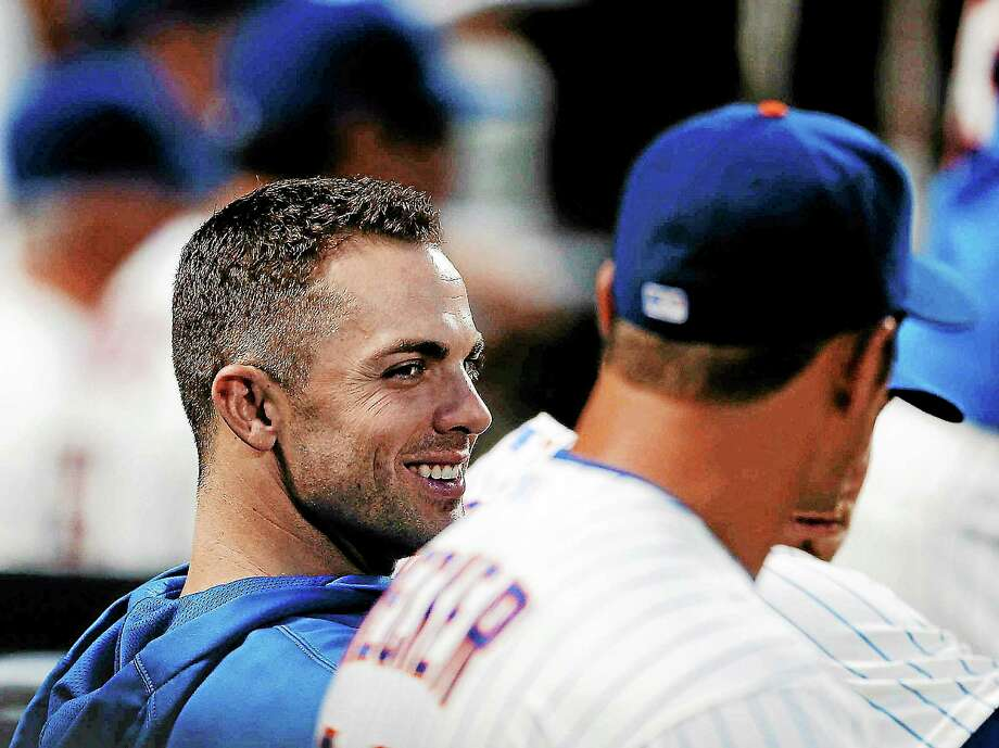 The Mets' David Wright talks with teammate Anthony Recker while watching his team play the Colorado Rockies on Aug. 7 in New York. Photo: Frank Franklin II — The Associated Press   / AP