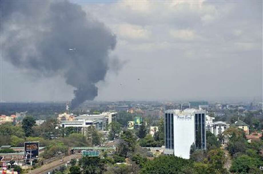 Black smoke billows above the Westgate Mall in Nairobi, Kenya, while under attack by a Somali terrorist group last month. Authorities are investigating if two Somali men killed in an accidental detonation in Ethiopia are affiliated with the same group. Photo: AP / AP
