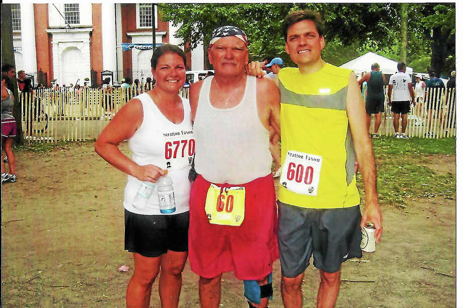 Robert Lampo, with his son Craig Lampo and daughter Kim Dempsey at last year's New Haven Road Race. In honor of their father, who died in March, Craig will wear the No. 60 bib and Kim, his American flag bandana. Photo: Submitted Photo