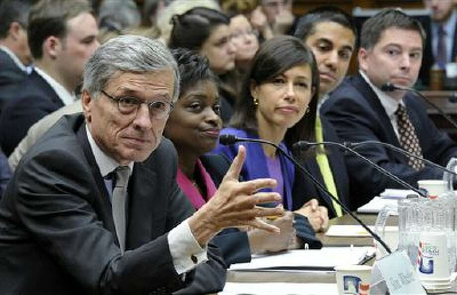 Federal Communications Commission Chairman Tom Wheeler, left, testifies last Thursday on Capitol Hill in Washington before the House Energy and Commerce Committee hearing on cell phones on planes. Photo: AP / AP
