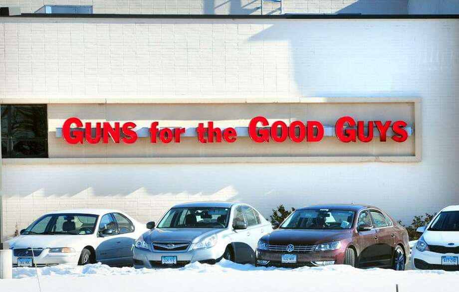 A sign reading, Guns for the Good Guys, hangs at Hoffman's Gun Center & Indoor Shooting Range on the Berlin Turnpike in Newington  on 1/7/2012.Photo by Arnold Gold/New Haven Register  AG0479C