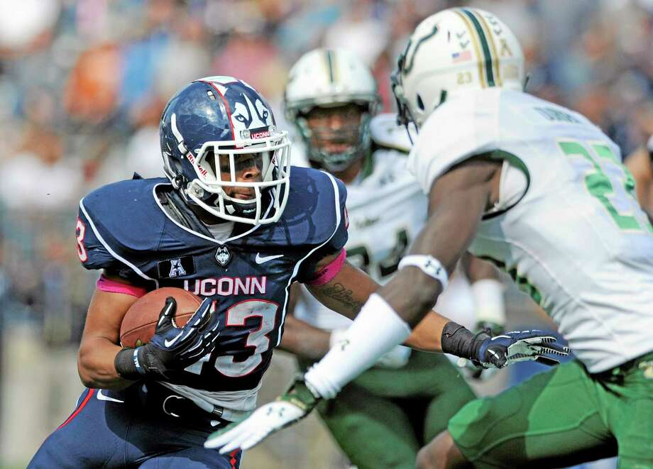 Led by running back Lyle McCombs, UConn outgained South Florida in the first quarter 139-12 on Saturday but were unable to carry over the early momentum. Photo: Fred Beckham — The Associated Press   / FR153656 AP