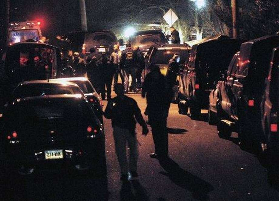 Norwich and state police respond to a standoff in Norwich, Conn., Monday, Jan. 7, 2013. A reportedly suicidal man shot and critically wounded a Norwich police officer during a lengthy standoff that stretched into Monday night, police said. Norwich police Officer Jonathan Ley was listened in critical condition, Yale-New Haven Hospital spokesman Mark D'Antonio said. Police at the scene said Ley was shot multiple times. (AP Photo/The Norwich Bulletin, Aaron Flaum) Photo: AP / The Norwich Bulletin