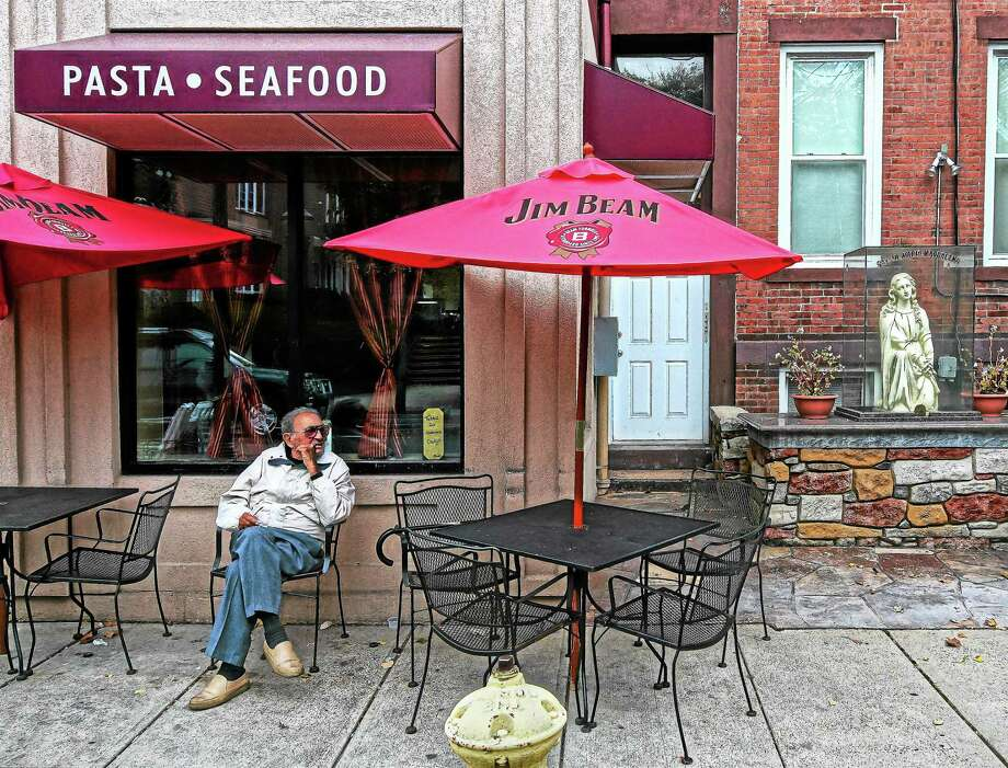 "Louis ""Donald"" Lamberti has seen many changes over the 84 years he has lived in Wooster Square. Here he enjoys some people-watching during the early afternoon in front of Ansitasio's Restorante on Wooster Street. Photo: Peter Casolino — New Haven Register"
