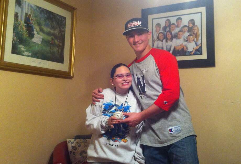 Northwestern's Zach Risedorf stands with his sister Stefanie Gutierrez who was one of his inspriations as he participated in a home run derby at Marlins Park in Miami. Submitted photo
