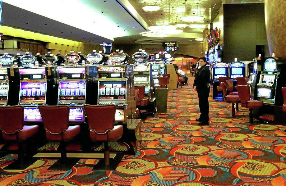 FILE - In this May 13, 2008 file photo, one of the slot machine rooms at the new MGM Grand Hotel stands ready for the start of business at the Foxwoods Resort Casino in Mashantucket, Conn. The spread of casino gambling is reaping billions of dollars for industry and government coffers, but also is creating more compulsive gamblers. Advocates for treatment services point to gaps between the amount of money states receive and what they spend on compulsive gambling. In 2012, Connecticut's gambling industry generated almost $659 million in state revenue, while problem gambling services received $1.9 million. (AP Photo/Bob Child, File) Photo: AP / AP