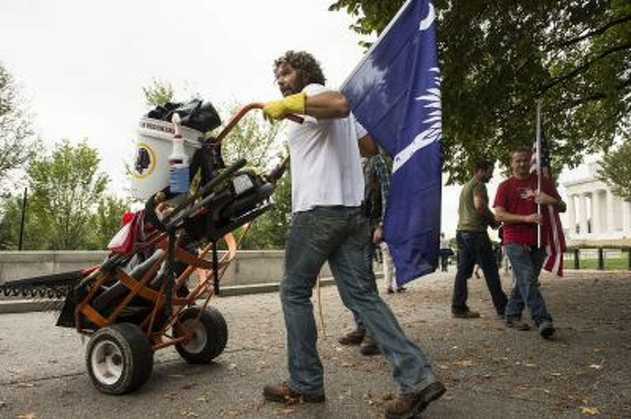 "Chris Cox of Mount Pleasant, S.C., readies supplies for cleaning on Saturday, He plans to clean the National Mall grounds until the shutdown ends. ""At the end of the day, we are the stewards of these buildings that are memorials,"" he says. Photo: THE WASHINGTON POST / THE WASHINGTON POST"