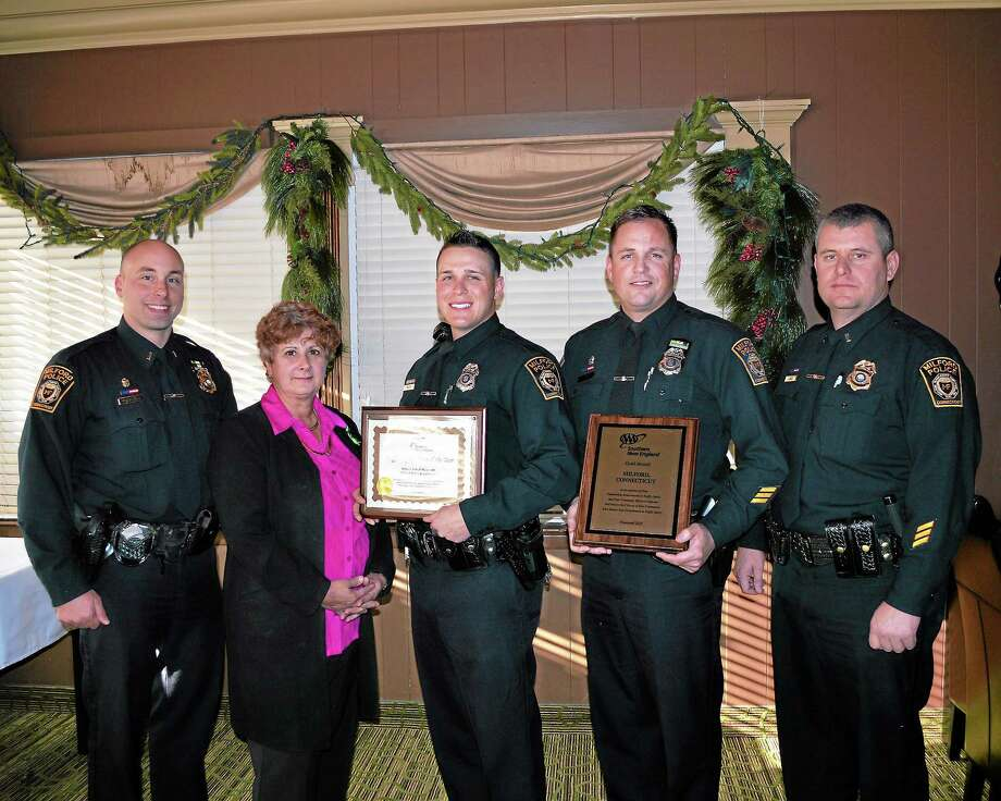 At AAA's Fourth Annual Community Traffic Safety Awards lunch, Public Affairs Manager Fran Mayko, second from left, presented a Traffic Safety Hero Award to Officer Mauro, third from left. Also attending the event were, from left, Lt. Brandon Marschner; Officer Jeff Nielsen, who holds the department's Gold Award; and Lt. William Cable. Photo courtesy of AAA Photo: Journal Register Co.