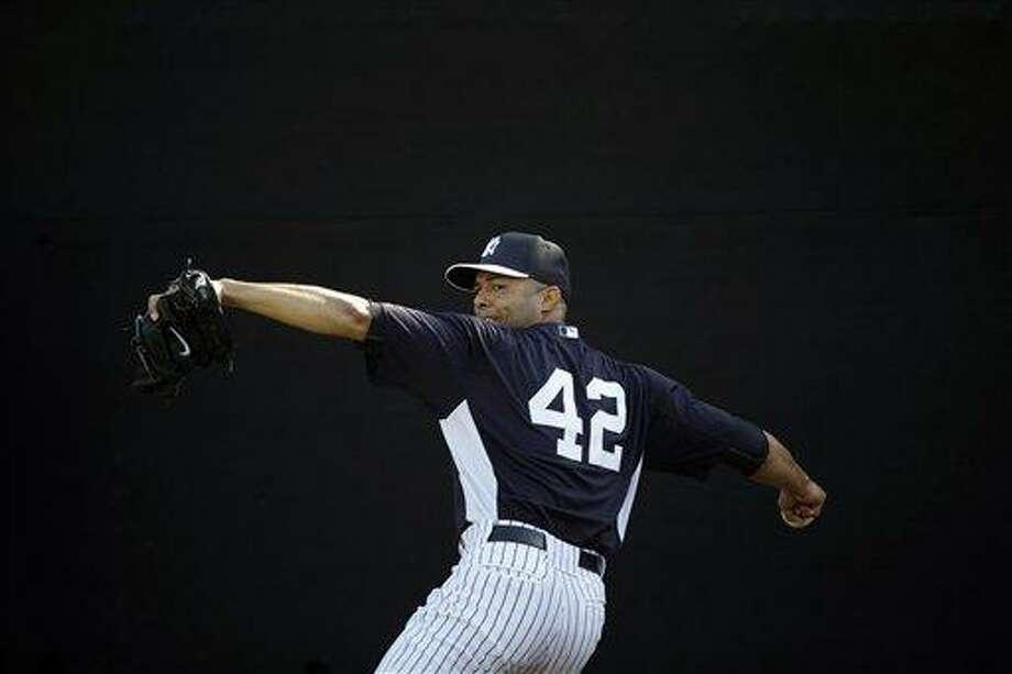 New York Yankees' Mariano Rivera pitches during a workout at baseball spring training, Saturday, Feb. 16, 2013, in Tampa, Fla. (AP Photo/Matt Slocum) Photo: ASSOCIATED PRESS / AP2013