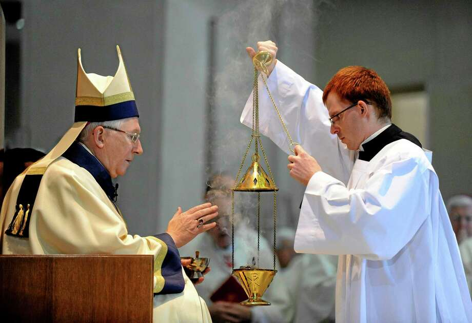 The most Reverend Leonard P. Blair, left, and Sean Hoffman participate in Blair's Mass of Installation at the Cathedral of Saint Joseph in Hartford, Conn., on Monday, Dec. 16. 2013. (AP Photo/Fred Beckham) Photo: AP / FR153656 AP