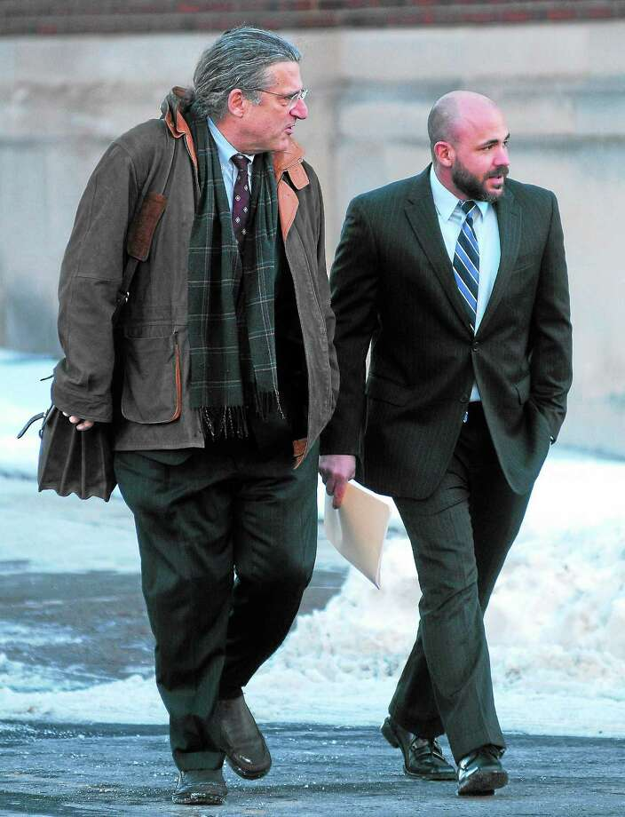 (Arnold Gold — New Haven Register) Former East Haven Police Officer Jason Zullo (right) walks into federal court in Hartford with his attorney, Norman Pattis, for sentencing on Monday 12/16/2013. Photo: Journal Register Co.