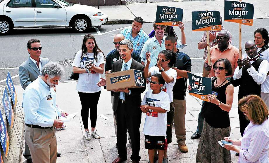 Mayoral candidate Henry Fernandez arrives at the Hall of Records to drop off over 6,000 signatures on petitions to be included on the primary ballot. (Peter Casolino — Register) Photo: Journal Register Co.