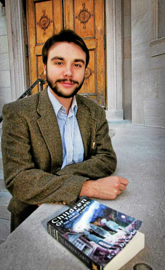 (Melanie Stengel — New Haven Register )   Author, Evan DeCarlo, on the steps of the Blackstone Library. DeCarlo was there giving a talk on his new Book 10/12. Photo: Journal Register Co.