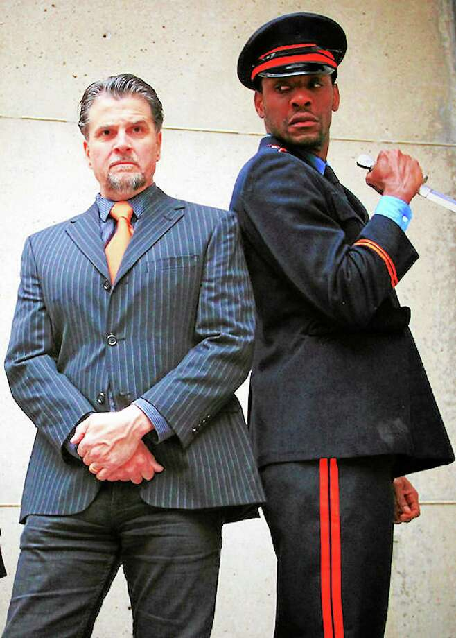 """James Andreassi, left, as Brutus, and Paul Pryce (Mark Antony) in """"Julius Caesar,"""" which ends Sunday evening. Photo: Mike Franzman"""